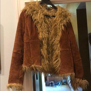 Leather coat moda international